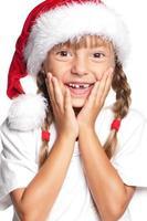 liten flicka i santa hatt foto