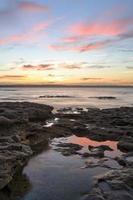 mycket vacker solnedgång murrays stranden Jervis Bay foto