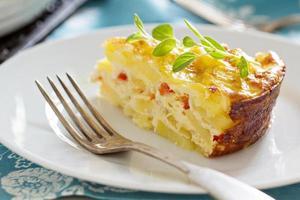 potatis och peppar frukost gratin foto