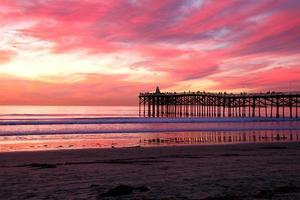 rosa strand solnedgång foto