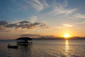 solnedgång till havs foto