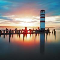 havets fyr solnedgång foto