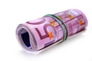 rulle med pengar och båge foto