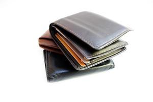 pengar plånbok plockade ovanpå varandra foto