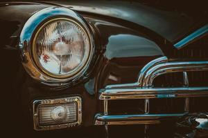 vintage bil strålkastare. bearbetning av vintage effekt foto