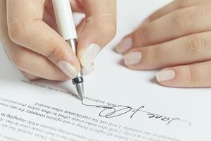 undertecknande av affärsavtal foto