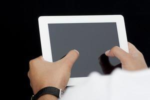 pekskärm på tablet-pc foto