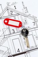 husplan med nyckel foto