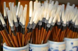kinesiska kalligrafi målarborstar foto
