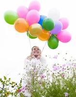kvinna med ballonger foto