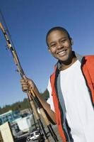 tonårspojke fiske foto
