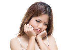 olycklig asiatisk kvinna foto