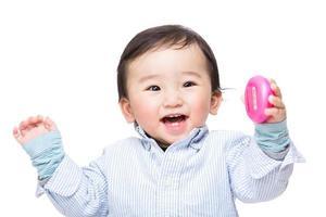 asiatisk baby känner sig upphetsad foto