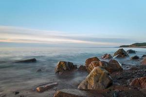 havsstrand (långsam slutartid) foto