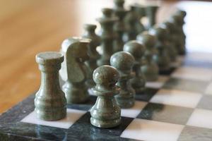 marmor schackpjäser foto