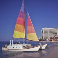 waikiki beach, segelbåt foto