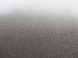 Punaluu svart sandstrand. foto
