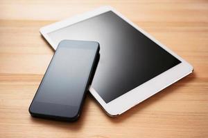 surfplatta och mobiltelefon foto