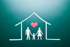 familj i ett hus foto
