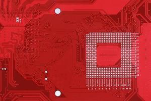 röd kretskort textur bakgrund av datorns moderkort foto