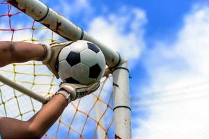 fotbollsmålvaktens händer foto