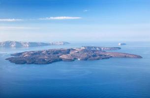 santorini - öarna nea kameni och palea kameni foto