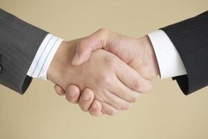 handskakningen till affärsmannen foto