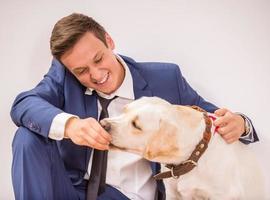 affärsman med hund foto