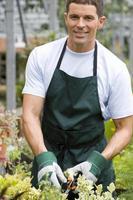 trädgårdsmästare i plantskola, leende, porträtt foto