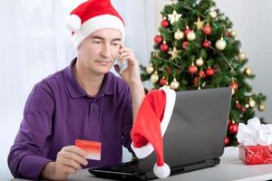 online-shopping med kort och med telefon foto