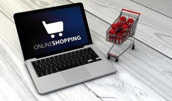 bärbar dator och vagn shopping online foto