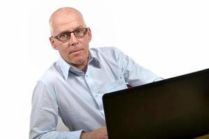 äldre affärsman på kontoret foto