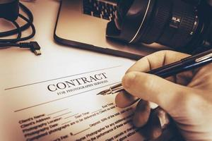 kontrakt för fototjänster foto