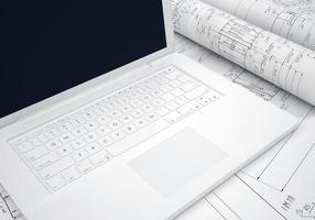 rullar teknikritningar och bärbar dator foto