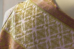 vacker silkedräkt traditionnel thai foto