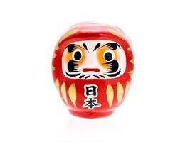 daruma lycklig docka av japansk, på vit bakgrund foto
