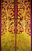 guldmålad dörr foto