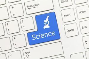 vitt konceptuellt tangentbord - vetenskap (blå tangent) foto