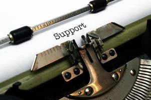stödtext på skrivmaskin foto