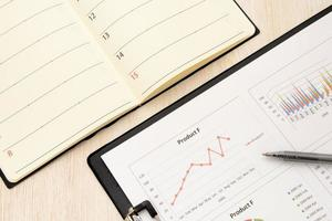 affärsdiagram och personlig organisator foto