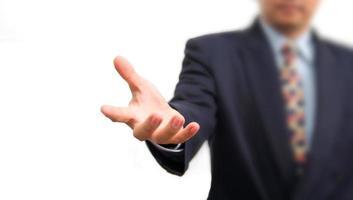 affärsman som håller på whiteboard, selektiv fokus på handen. foto