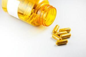 gurkmeja-tabletter med kapslar foto