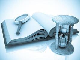 öppen bok med timglas och förstoringsglas foto