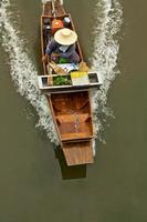 långsvansad båt foto