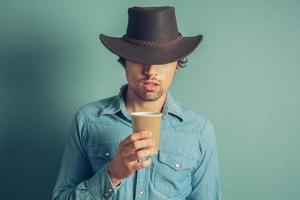 cowboy som dricker kaffe foto