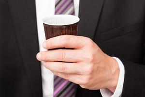 affärsman som dricker kaffe