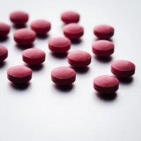 röda tabletter foto