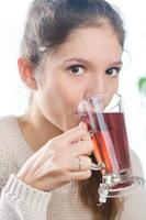 dricker te. foto