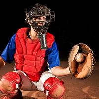 basebollspelare (catcher) på hemmaplattan foto