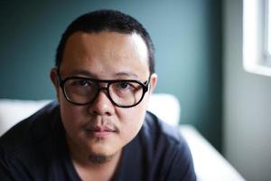 ung asiatisk man foto